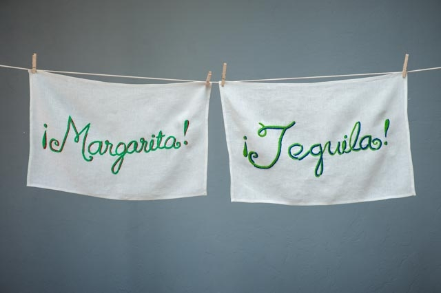 "We designed our Sal del Mar hand-embroidered bar towels with the idea that we could take an ordinary setting and make it say ""party."""