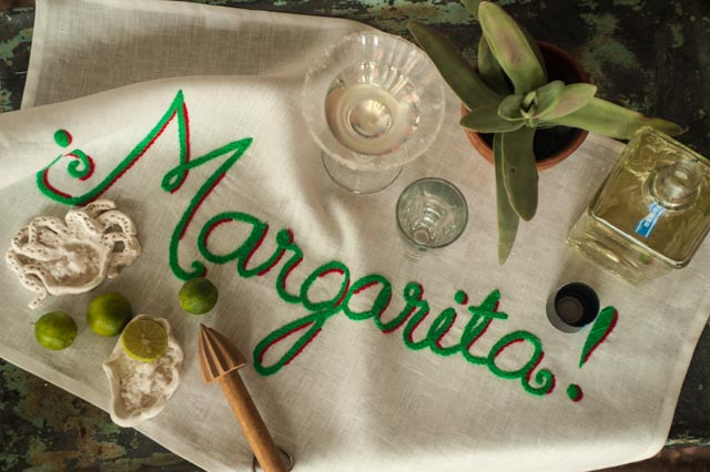 Of course, you can even find a place on the countertop in the kitchen and try out the Margarita bar towel with its magnificent sprawling letters in lime green. You will set out your beloved tequila. Set out limes, a shaker and martini-styled glasses rimmed with our Sal del Mar gourmet sea salt. And voila!