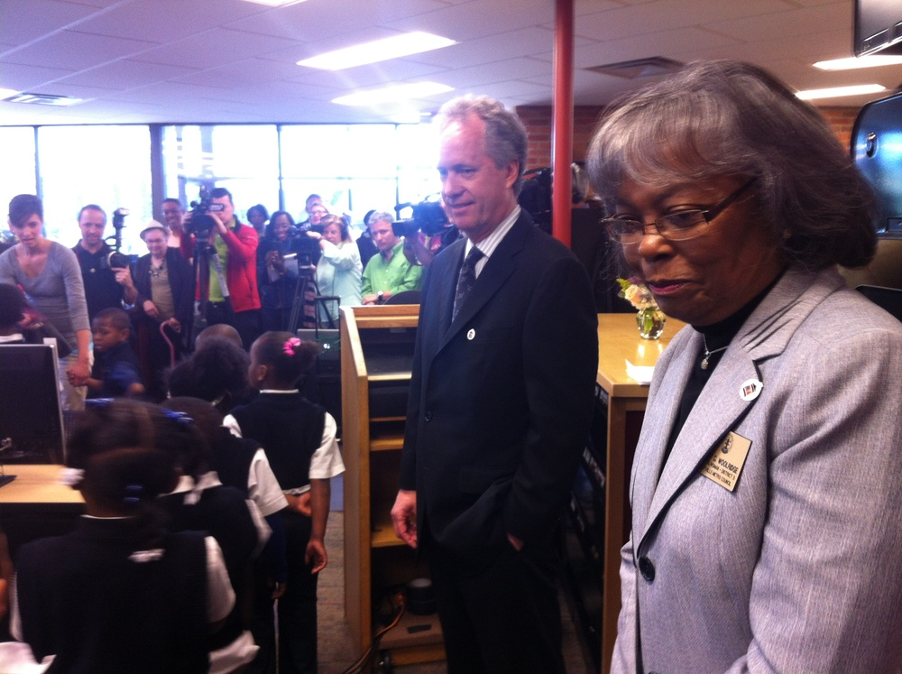 Mayor Greg Fischer and Councilwoman Mary C. Woolridge look on as students use the new computers in the recently renovated Shively Library for the first time.