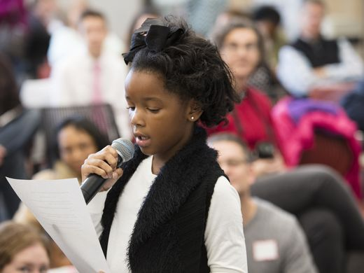 7-year-old I'Leana McGhee reads part of her award winning essay to the crowd at Southwest Regional Library for the annual Share a Story event. (Photo by Philip Scott Andrews/Special to The Courier-Journal.)