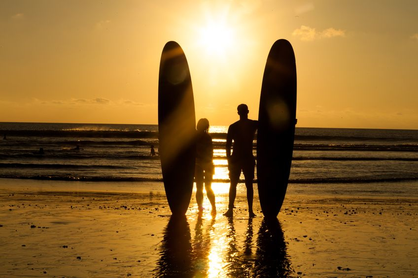 surfer couple sunset.jpg