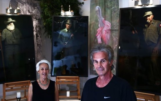 Connie Bransilver and Nicholas Petrucci with Guardians of the Everglades portraits and silk banners.