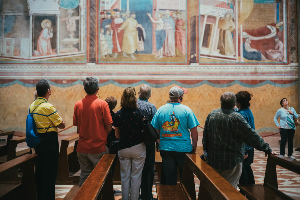 Guided tour among the Giotto frescos in Assisi.