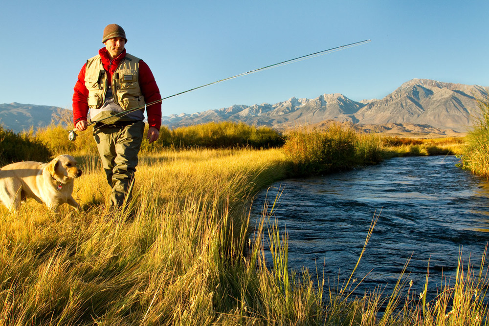 Lifestyle: Brian Harry fly fishing the Owens River at sunrise in late Autumn, Eastern Sierra, California