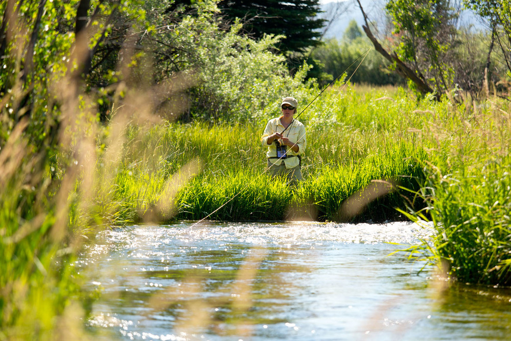 Lifestyle: Kara Armano fly fishing a spring creek along the Roaring Fork River, Carbondale, Colorado