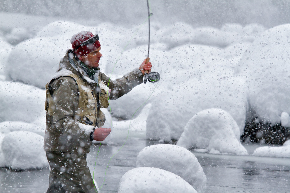 Lifestyle: Chris Solomon fly fishing in the snow, South Fork of the Stillaguamish River, Mt. Baker-Snoqualmie National Forest, Washington