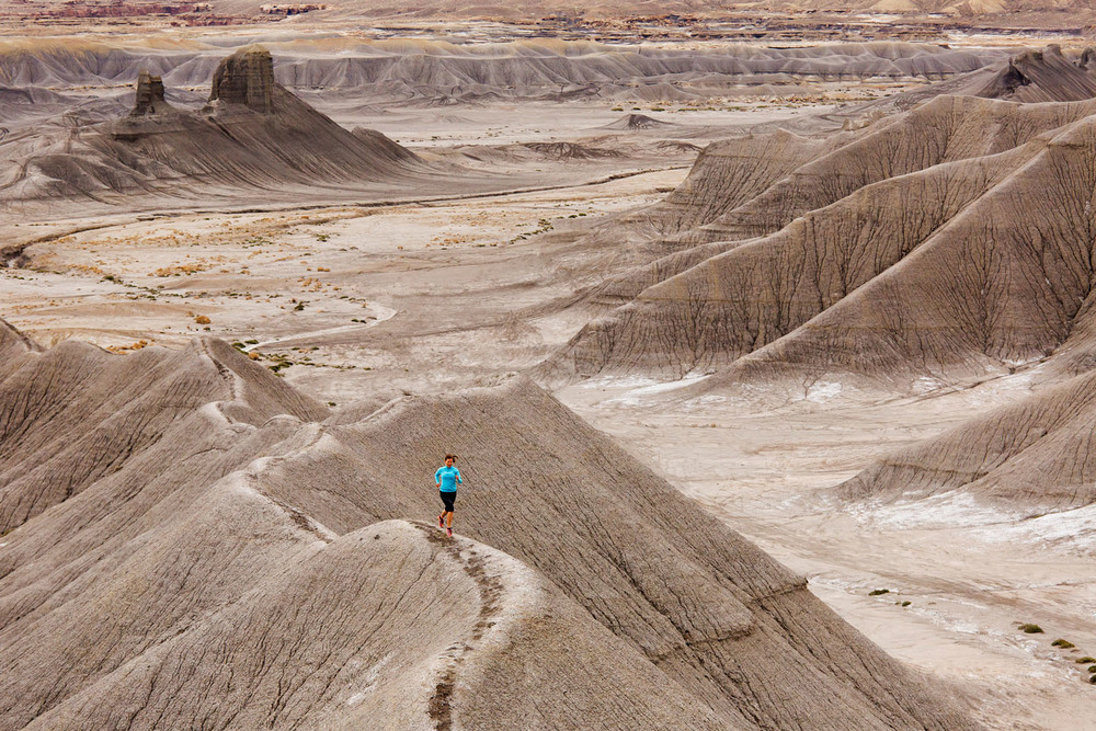 Adventure: Melissa Hagedorn trail running in the Cainville Mesa badlands, Cainville, Utah