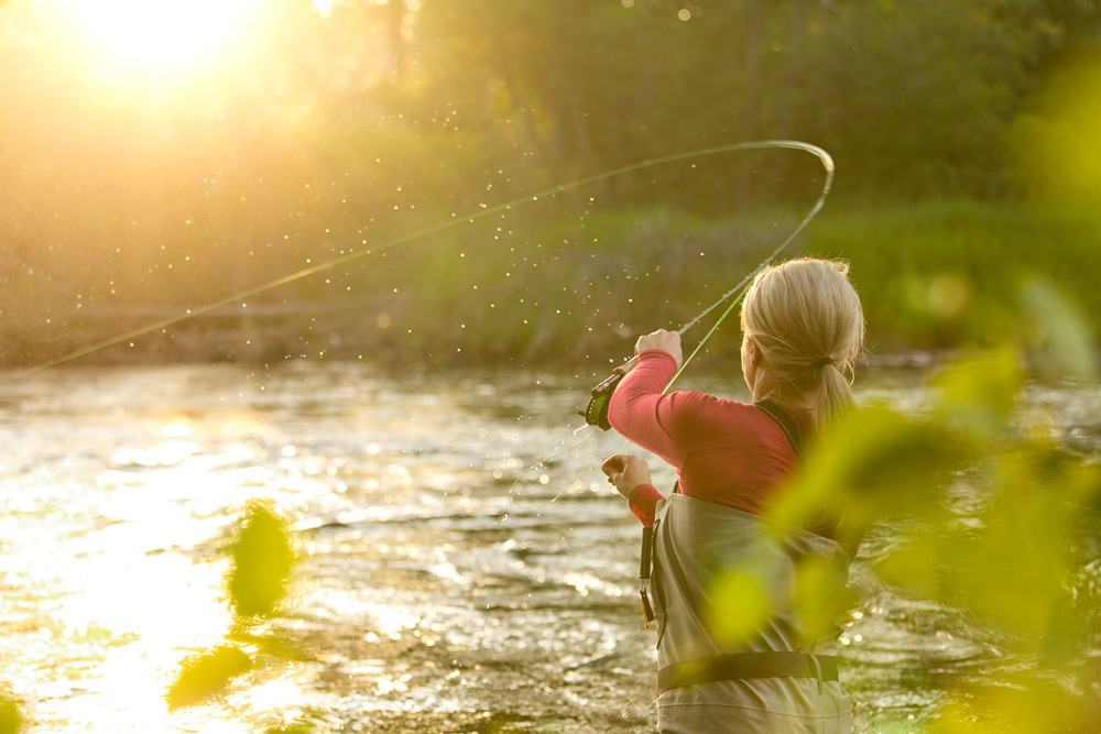 Lifestyle: Kathleen Hasenoehrl fly fishing on the Yakima River at sunset, Central Cascades, Washington