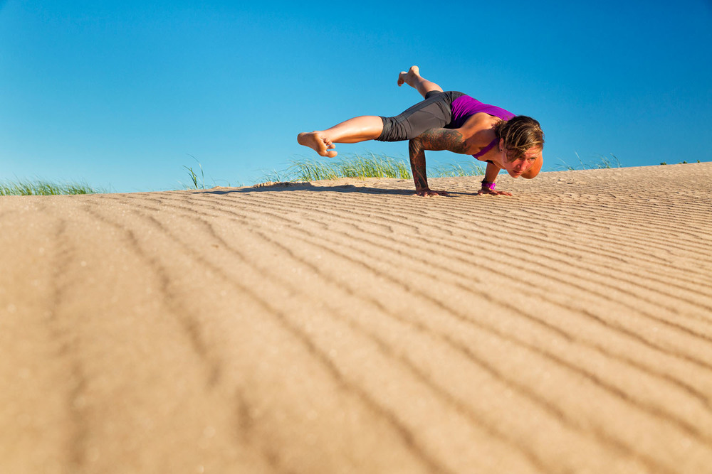 Lifestyle: Jenn Haase practicing yoga at Sleeping Bear Dunes National Seashore in summer, Lower Peninsula, Michigan