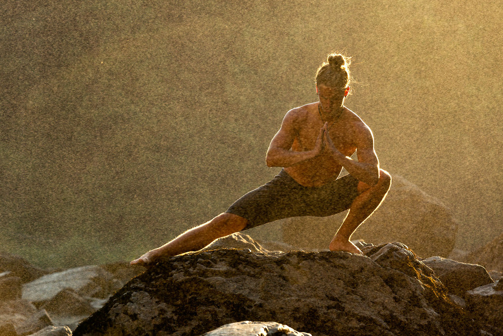Lifestyle: Jamie Finnan practicing yoga below Snoqualmie Falls, Central Cascade Mountains, Washington