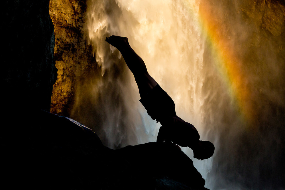 Lifestyle: Gabriel Juzon practicing yoga below Snoqualmie Falls, Central Cascade Mountains, Washington