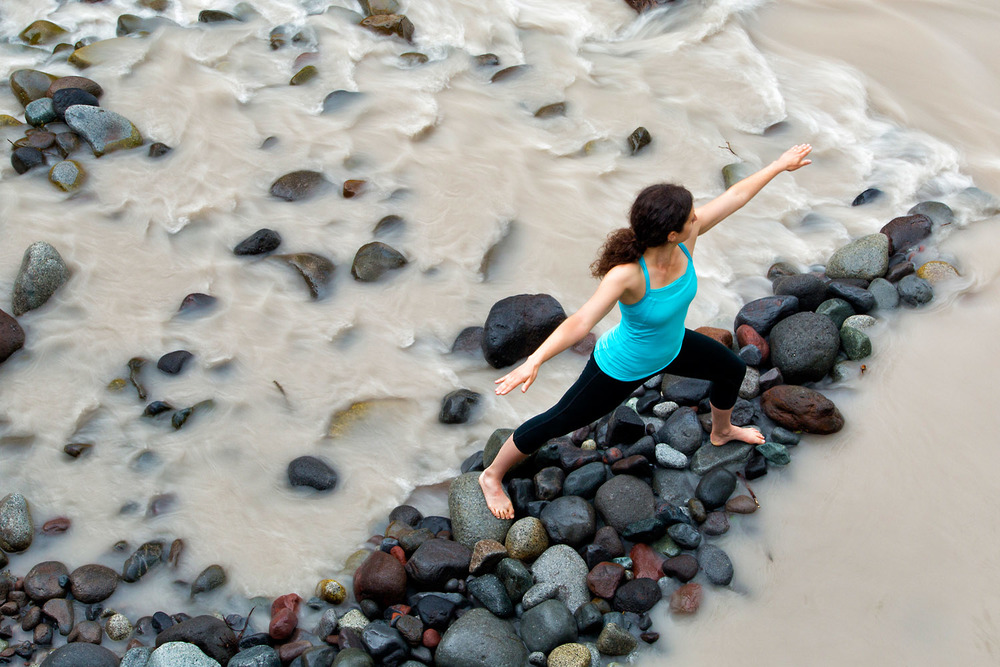 Lifestyle: Elizabeth Kovar practicing yoga in the Carbon River Valley, Mt. Rainier National Park, Washington