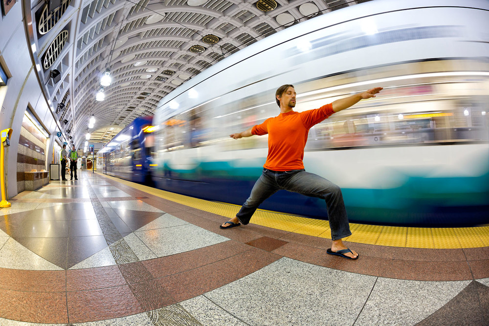 Lifestyle: A man practicing urban yoga in Pioneer Square train tunnel, Seattle, Washington