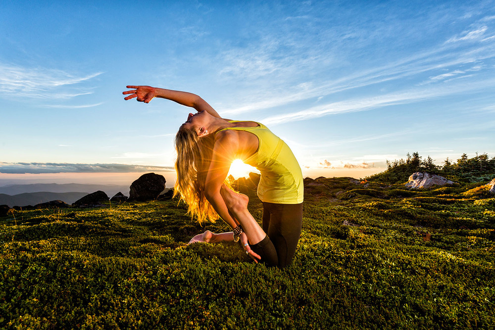 Lifestyle: Kristen Shaw practicing yoga in the wilderness of Mt. Rainier at sunset, Mt. Rainier National Park, Washington