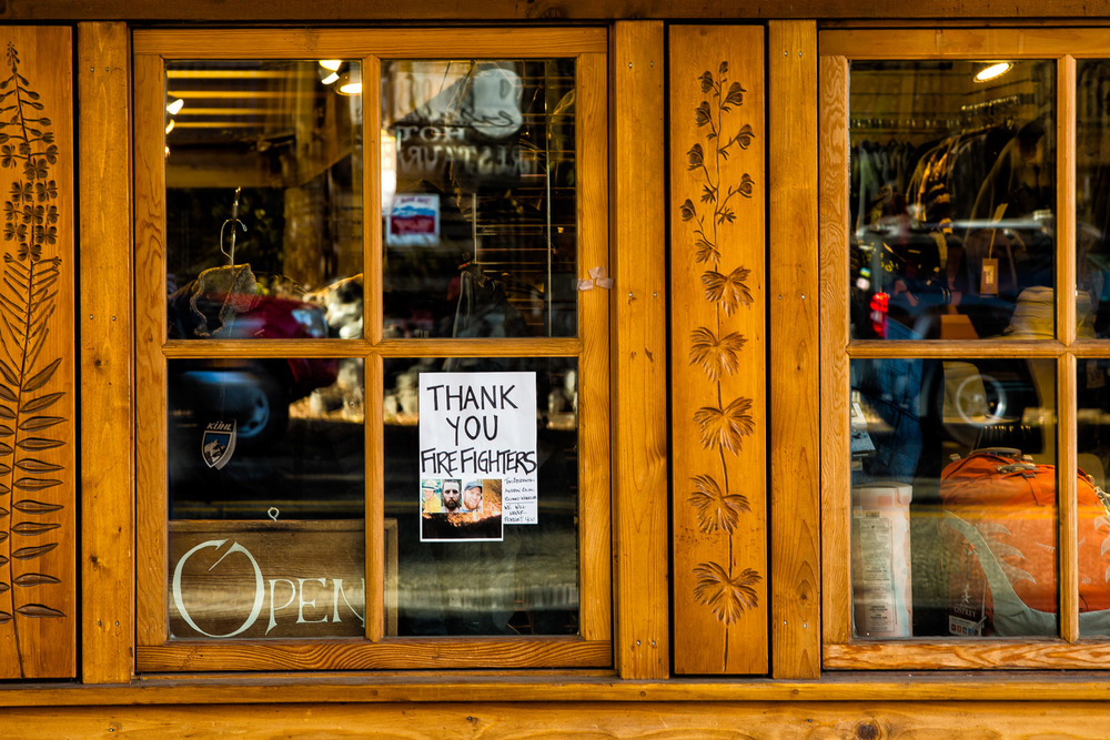 Conservation: A sign in the window of Methow Valley Sports in Winthrop, Washington, thanking firefighters and mounring the loss of three firefighters in the devestating wildfires of summer of 2015