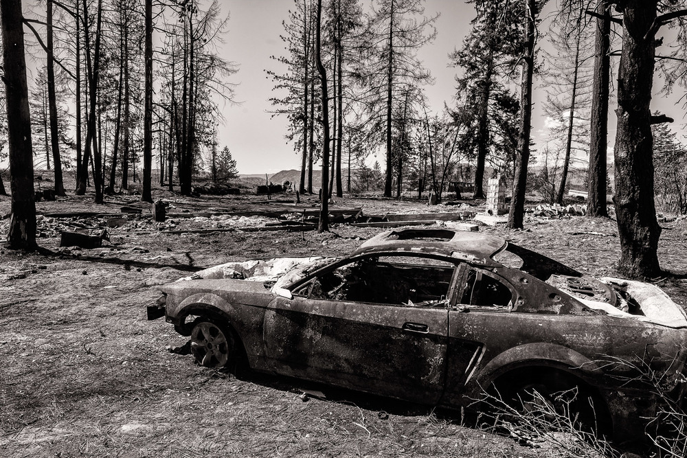 Conservation: A burned car and home after a record breaking wildfire in Eastern Washington