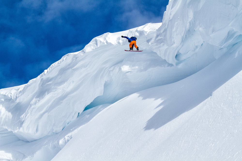 Adventure: Shawn Freyer drops off a huge cornice while snowboarding in the Mt. Baker backcountry, Mt. Baker Wilderness