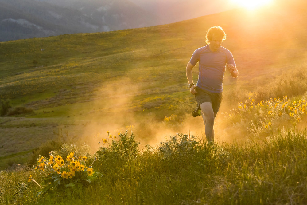 Adventure: Chris Solomon trail running on a ddry, dusty evening in the Methow Valley in spring, Washington