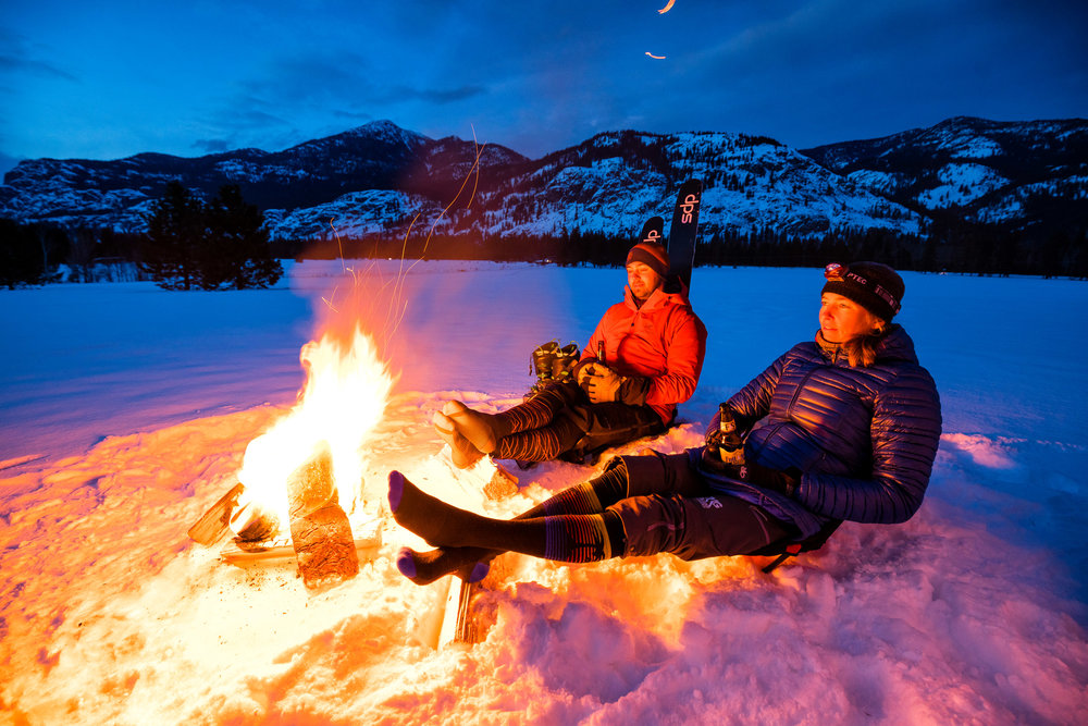 Lifestyle: A couple relaxing after a backcountry ski tour in the Methow Valley, Washington
