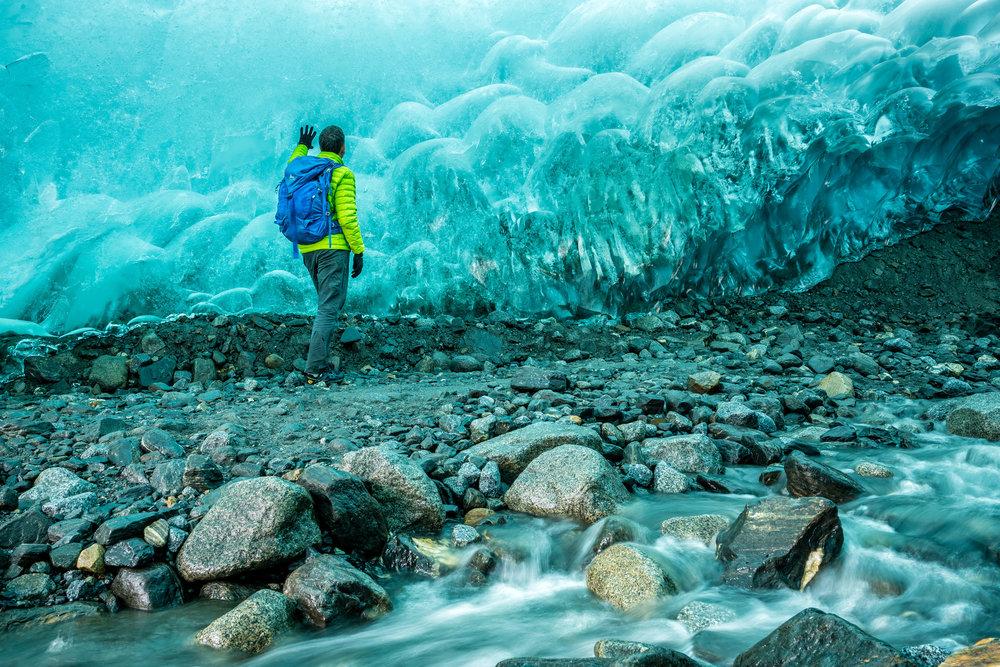 Adventure: A man explores an ice cave beneath the Mendenhall Glacier, Juneau Icefield, Alaska