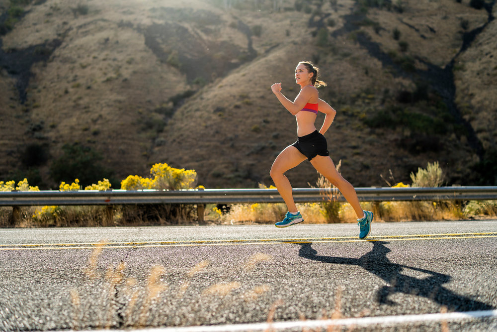 Adventure: A young woman road running in late summer in Yakima Canyon, Washington