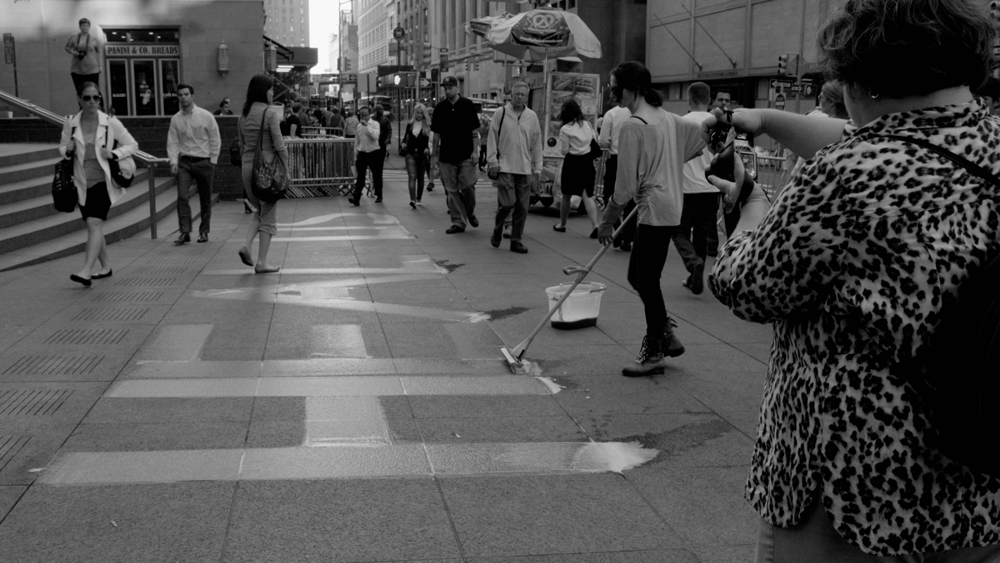 HEAL US/ HEAL U.S. Zuccotti Park, New York NY, USA. September 11, 2012. Duration: 8 hours and 27 mins. Materials: Purified water, Meyer's All Purpose Cleaner with geranium oil, sponge mop. Photo: David Bourla.