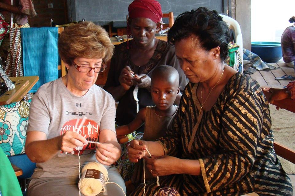 Carol shares her crocheting skills with the women at the sewing center in Burundi.