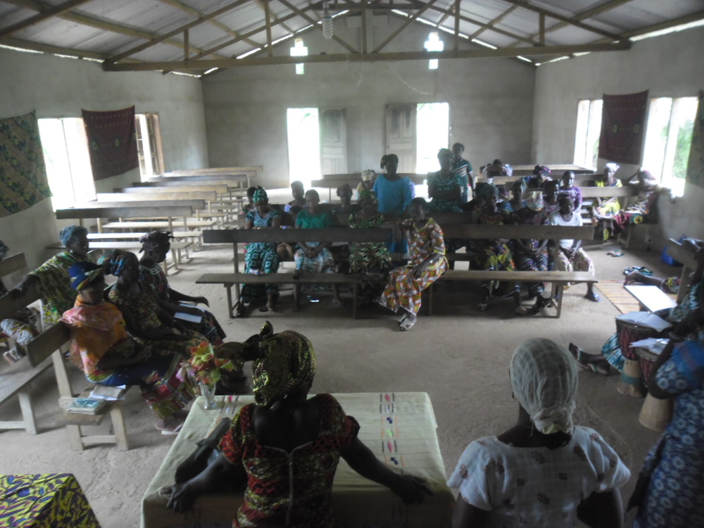 Madeleine and her team, meeting with women in West Africa to share how they can best combat Ebola in their communities.
