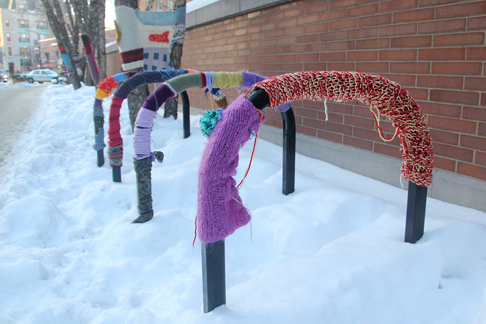 "The yarn is holding tight on Feb. 9, 2014, around bike racks and trees one day after a public art installation, a ""yarn bomb"" in Evanston, Ill. (ANNE EVANS/MEDILL)"