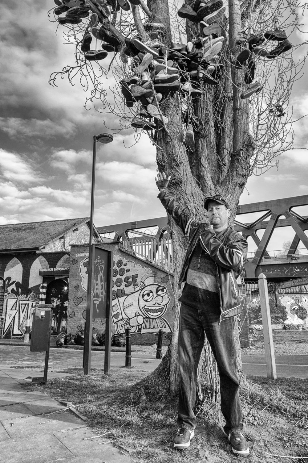 I met this guy on the walk home. He explained how he had collected these shoes from miles around to build his shoe tree. He was happy to get photographed provided I parted with some spare change.