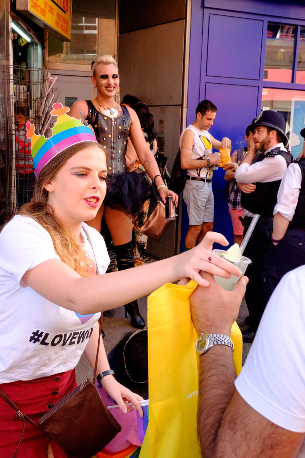 """The diversity of the crowd was truly admirable. """"Hold my drink!"""" to a stranger as she snapped a photo of the lady in drag with a policeman."""