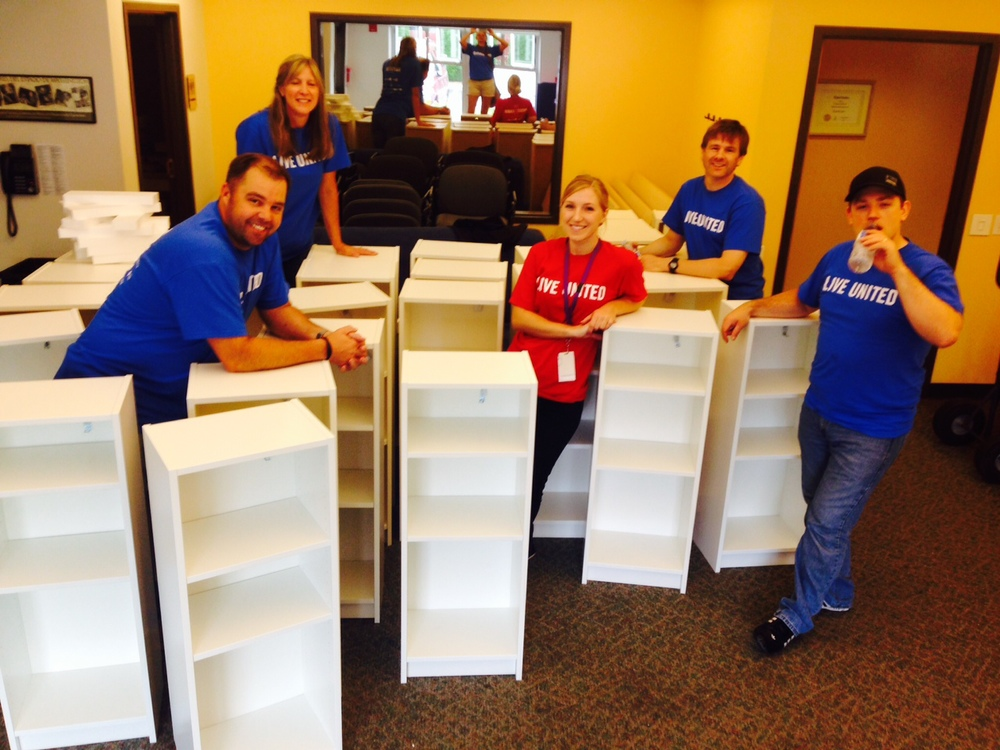Our team with some of the bookshelves built for The Kindering Center in Bellevue, Washington.