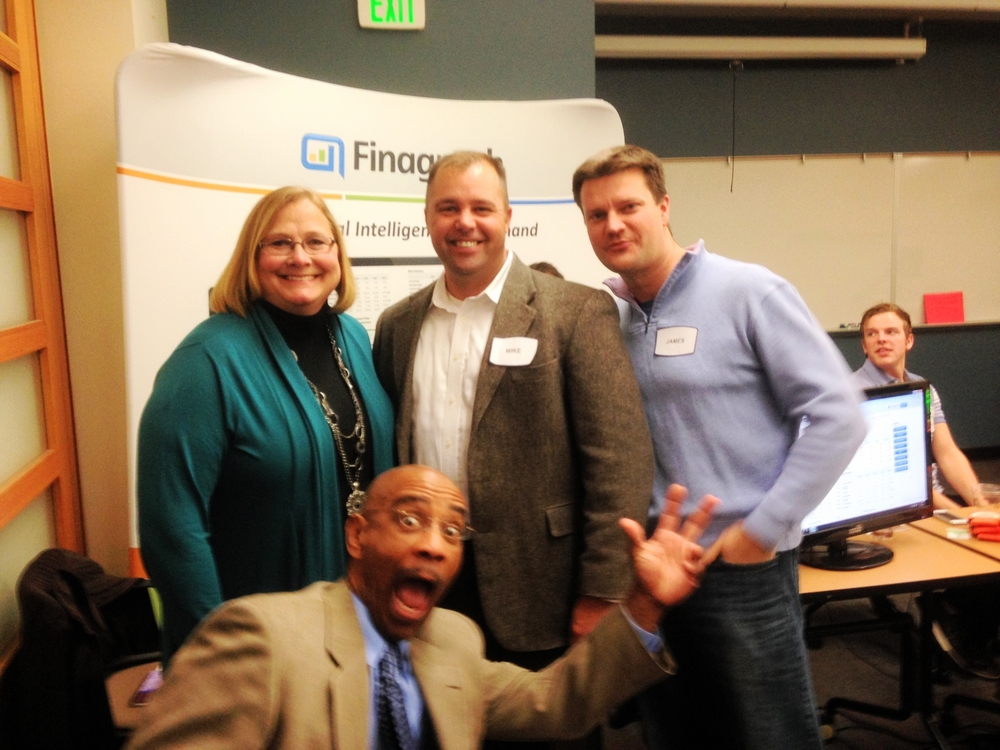 FROM LEFT TO RIGHT: MICHELLE LONG, CPA, MIKE MILAN, SVP OF FINAGRAPH AND JAMES WALTER, CEO OF FINAGRAPH, and robert burns of worldpay