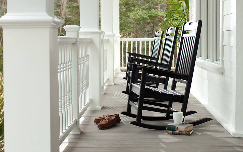 trex-transcend-porch-gravel-path-railings-classic-white-colornial-spindles-outdoor-furniture-black-rockers.jpg