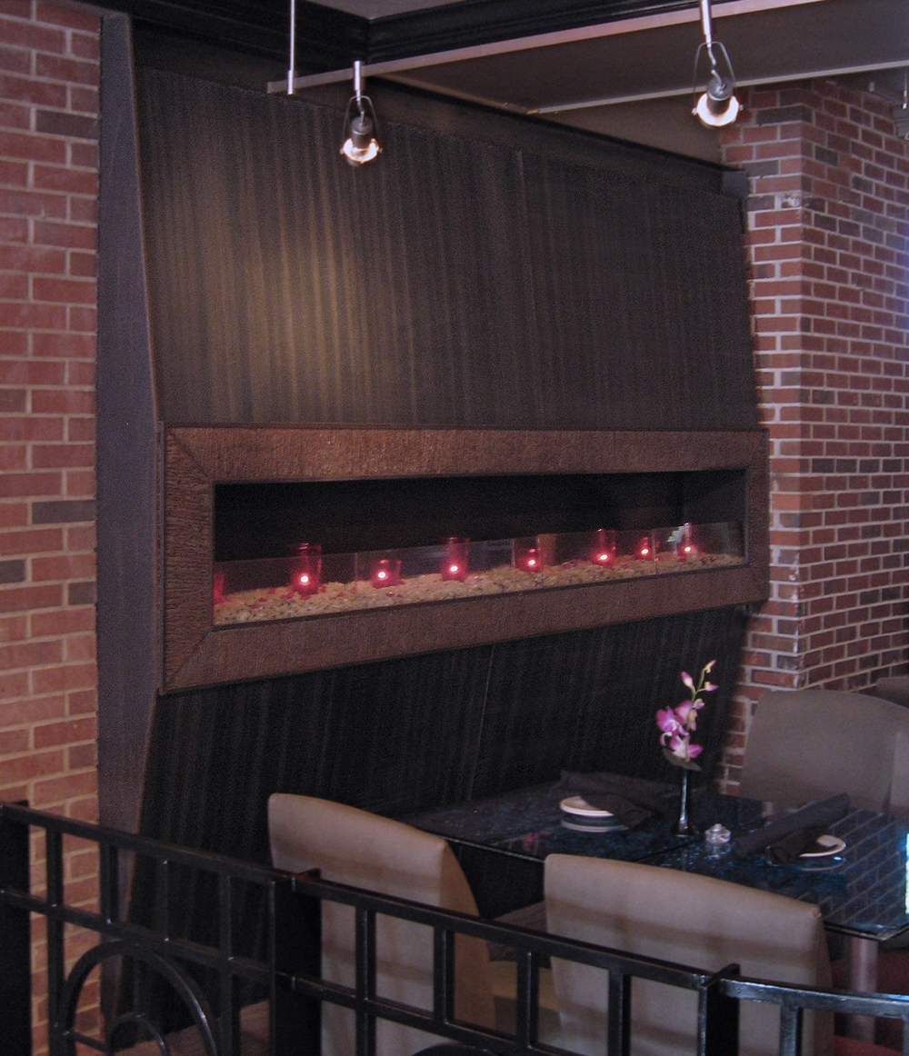 FAUX-WOOD FIREPLACE - PAOLO'S RESTAURANT
