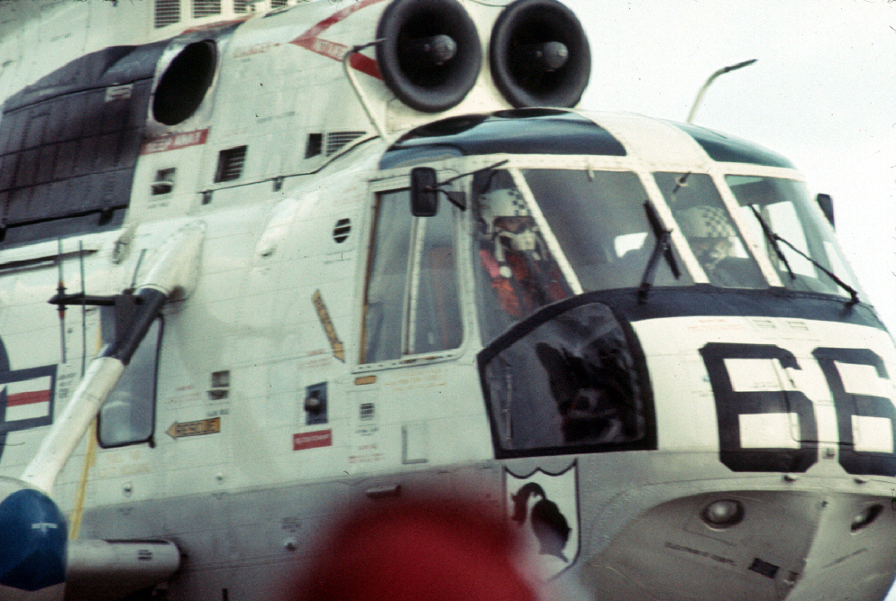 Co-pilot Bruce Johnson is on the far side of the cockpit as Helo #66 (with the three Apollo 11 astronauts inside) lands on Hornet's flight deck.