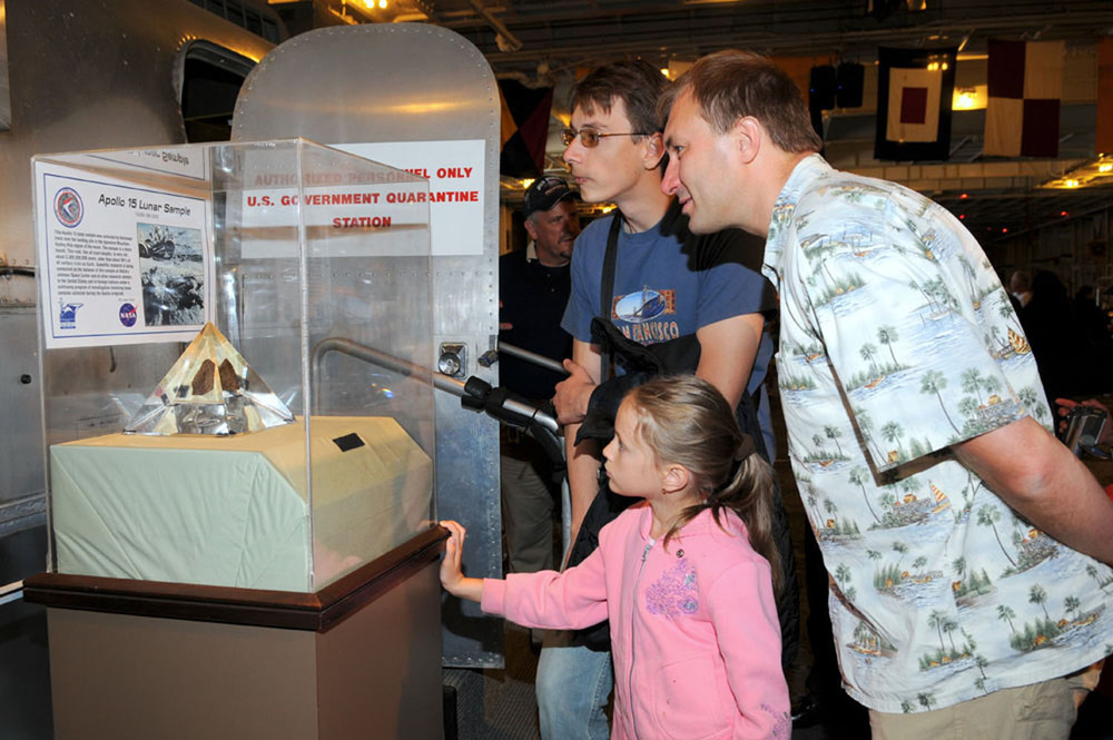 Visitors check out a moon rock during Splashdown 2009 | Photo by Susan Wood — More photos