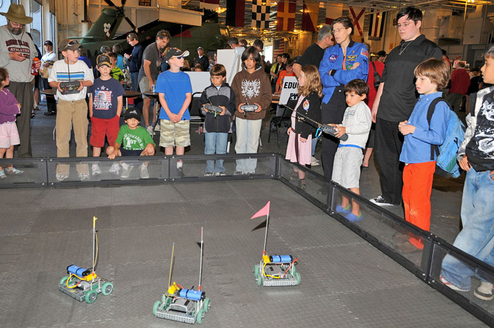Young visitors try their hands at operating mini rovers at Splashdown 2009 | Photo by Susan Wood — More photos