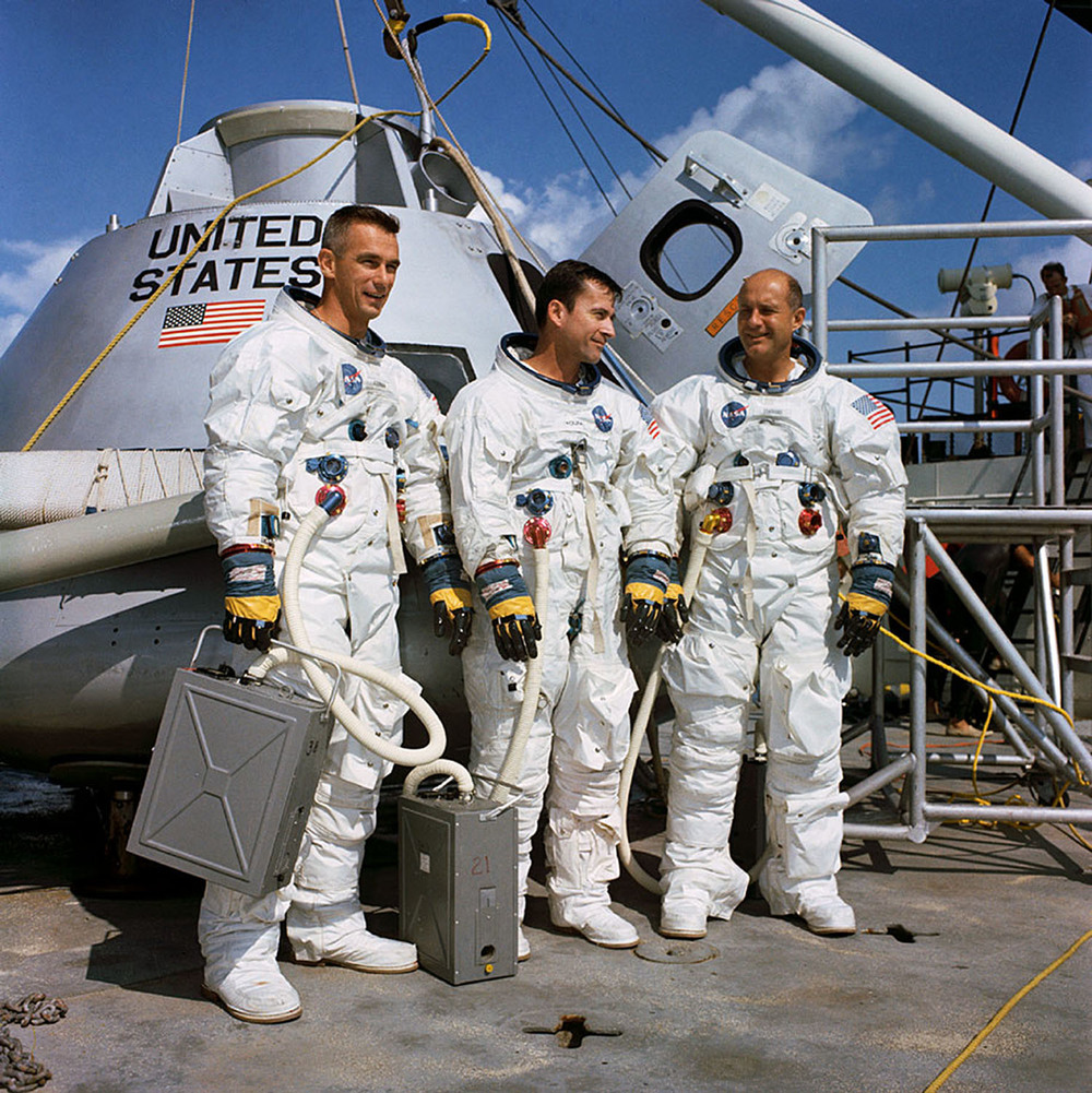 The Apollo 10 crew onboard the NASA M/V Retriever vessel in the Gulf of Mexico as they train for exiting the command module after splashdown.