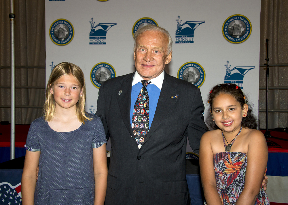 Buzz Aldrin with essay contest winners Grace Teuscher and Khushi Randev