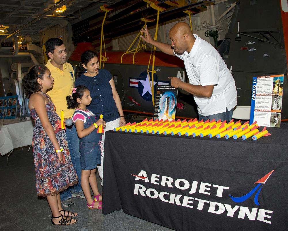 The Randev family visit the Aerojet Rocketdyne exhibit