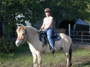 Lisa Miniken grew up riding at a summer camp in Eastern Washington. After graduating from Washington State University, she worked as an instructor for Redmond Parks & Recreation and for Little Bit Therapeutic Riding Center. Lisa obtained CHA certification in 2003 and continues to substitute teach at THS while working as a Program Manager at Microsoft. Lisa is an avid trail rider and spends most of her time at THS working with her horse DJ (also a THS school horse), helping with barn chores, and helping Dawn with training and schooling of the herd.