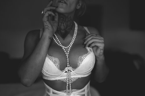 White lingerie and pearls