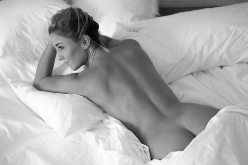 Cheeky white sheet boudoir