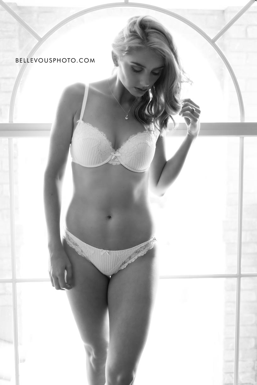 Brisbane boudoir model standing in front of a big window