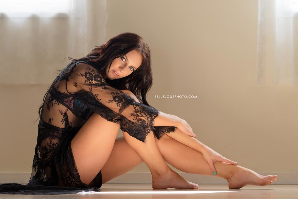 Brisbane boudoir model sitting on wood floor