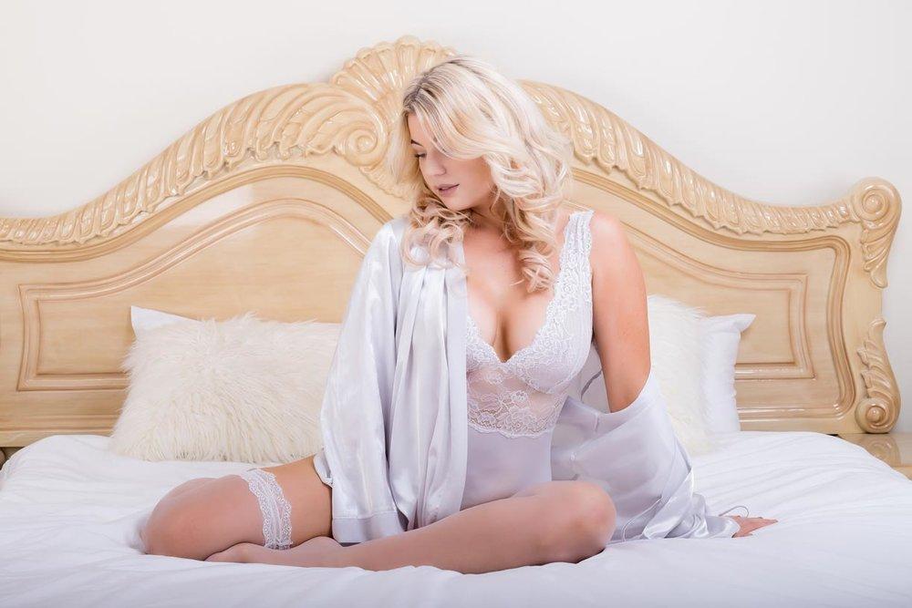 Brisbane bridal boudoir model sitting on a bed