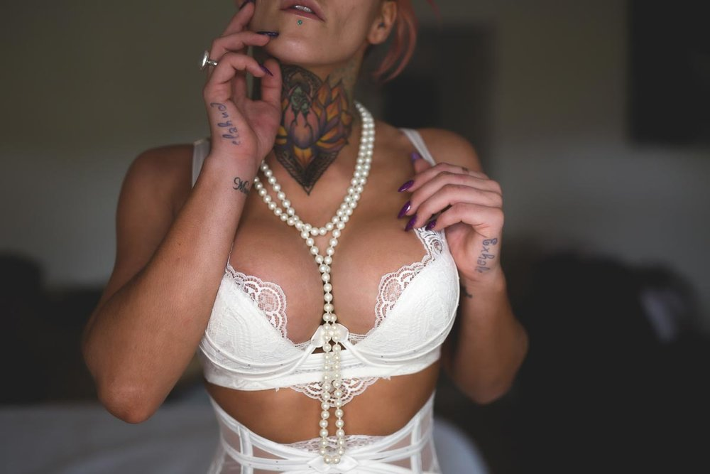 Boudoir model with pearl necklace draped over her