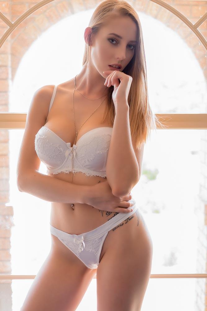 Brisbane boudoir model wearing bridal bras and panties