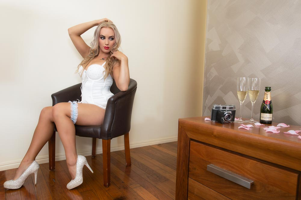 Brisbane woman wearing white bridal high heels for her boudoir session